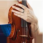 woman's hand hugging a violin