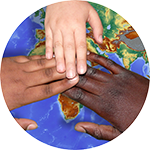three hands of various sizes and skin tones over a map of the world