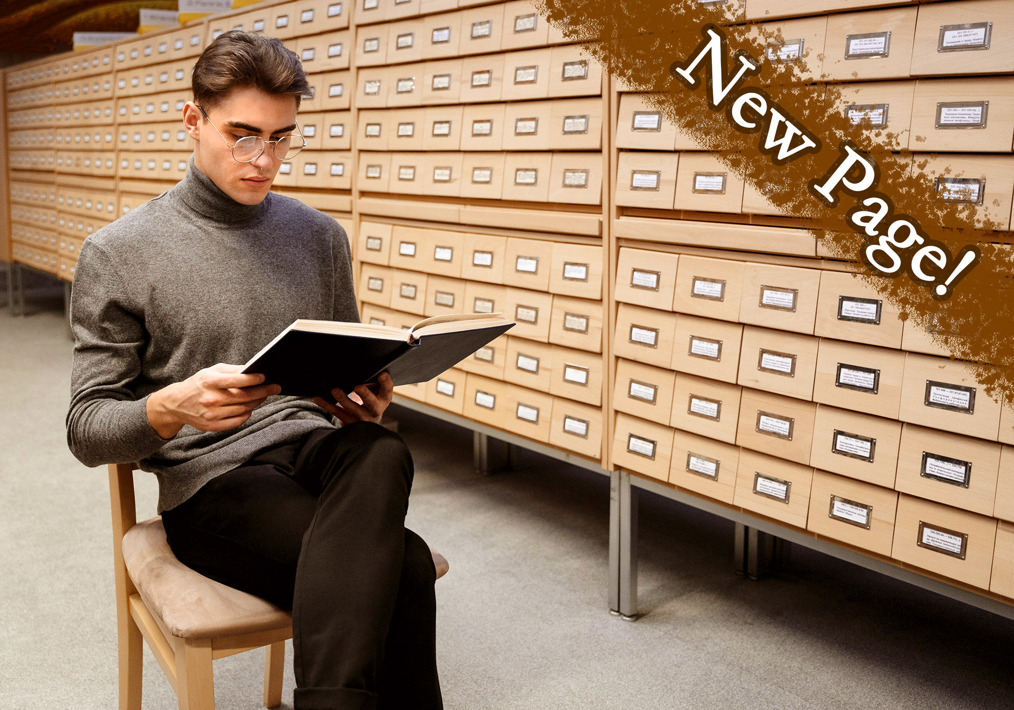 Young white man with a septum piercing reading a book in a room full of file cabinets