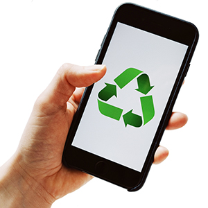 hand holding an digital device with a green recycling logo on the screen