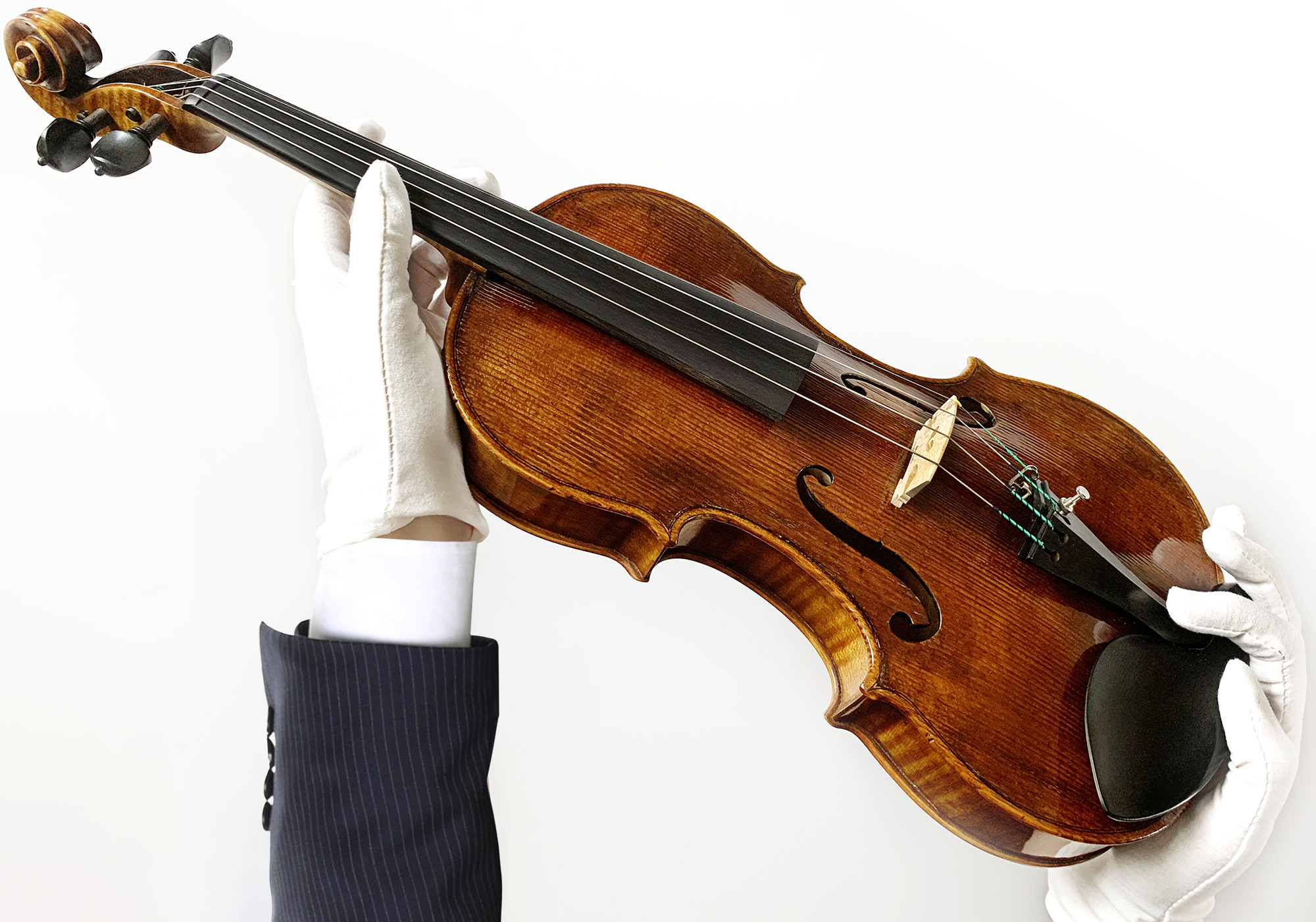 old violin obscured by wood case